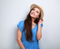 Happy casual woman in summer hat thinking about vacation and loo Royalty Free Stock Photos