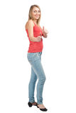 Happy casual womanl showing thumbs up Royalty Free Stock Photography