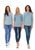 3 happy casual women walking forward and smile Royalty Free Stock Photos