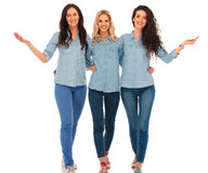 3 happy casual women walking and welcoming you Stock Images