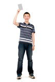 Happy casual young man in his raised hand holds a light clean sh Royalty Free Stock Photography