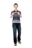 Happy casual young man holds his thumbs up Royalty Free Stock Photos
