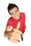 Happy casual young man showing thumb up Stock Photos