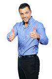 Happy casual young man showing thumb up Stock Photo