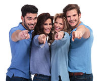 Happy casual young people pointing fingers. To the camera on white background Royalty Free Stock Images