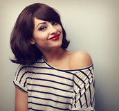 Happy casual young smiling woman with short hairstyle looking. V Royalty Free Stock Photo
