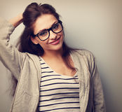 Happy casual young woman in eye glasses looking. Vintage portrai Stock Image