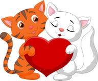 Happy cat couple cartoon holding red heart Royalty Free Stock Photo