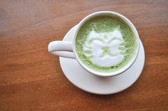 Happy cat latte green tea. The picture of hot latte green tea with lovely cat drawing stock images