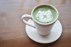 Happy cat latte green tea. The picture of hot latte green tea with lovely cat drawing royalty free stock image