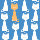 Happy cats seamless pattern against blue background, vector illustration Royalty Free Stock Images