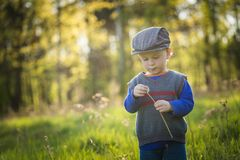Happy caucasian boy playing outdoor Royalty Free Stock Photo