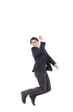 Happy caucasian businessman jumping in the air Royalty Free Stock Photos