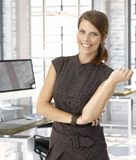 Happy caucasian businesswoman at office desk Royalty Free Stock Photos