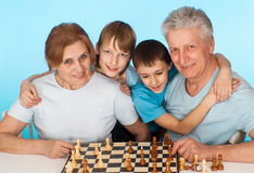 Happy Caucasian campaign of playing chess against Stock Image