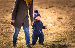 Happy caucasian child playing outdoor - walking with his mother Stock Photography