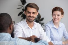 Happy caucasian hr manager handshake hire employ african american candidate. Happy caucasian company representative hr recruiter handshake hire employ african royalty free stock photo
