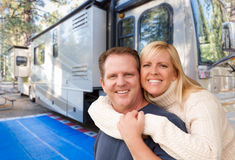 Happy Caucasian Couple In Front of Their Beautiful RV At The Cam Royalty Free Stock Images