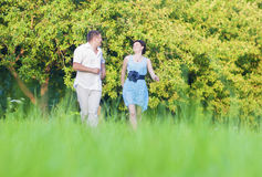 Happy caucasian Couple Having Good Time Outdoors Walking Together Stock Photos