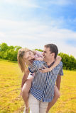 Happy Caucasian Couple Playing Outdoors in Summer. Having Fun Wh Royalty Free Stock Photos