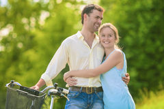 Happy Caucasian Couple Relationships. Sweethearts in the Park wi Stock Photo