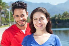 Happy caucasian couple in vacation looking at camera Royalty Free Stock Photos