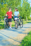 Happy Caucasian Couple Walking With Bicycles in Nature Surroundi Royalty Free Stock Images