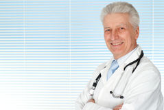 Happy Caucasian doctor with a stethoscope standing Stock Image