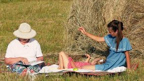 Happy caucasian family have picnic in the meadow stock footage