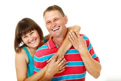 Happy caucasian family having fun and smiling over white. Wife hugs her husband Stock Photos