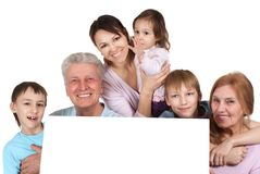 Happy Caucasian family holding the paper royalty free stock photo