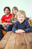 Happy Caucasian family portrait with smiling son Royalty Free Stock Images