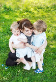 Happy caucasian family of three: Young mother and two little sib Stock Photography