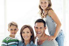 Happy caucasian family with two children - portrait royalty free stock photography