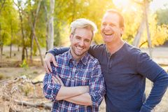 Laughing Caucasian Father and Son Portrait Outdoors. Happy Caucasian Father and Son Portrait Outdoors royalty free stock photo
