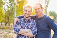 Handsome Caucasian Father and Son Portrait Outdoors. Happy Caucasian Father and Son Portrait Outdoors royalty free stock image