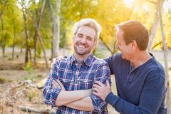 Affectionate Caucasian Father and Son Portrait Outdoors. Happy Caucasian Father and Son Portrait Outdoors royalty free stock photography