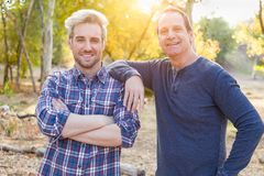Happy Caucasian Father and Son Portrait Outdoors. Attractive Caucasian Father Son Portrait Together Outdoors royalty free stock images