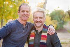 Smiling Caucasian Father and Son Portrait Outdoors. Happy Caucasian Father and Son Pose for a Portrait Outdoors royalty free stock photo