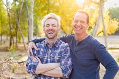 Laughing Caucasian Father and Son Portrait Outdoors. Happy Caucasian Father and Son Portrait Outdoors royalty free stock image