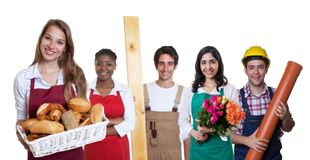 Happy caucasian female baker with group of other international a. Pprentices on an isolated white background for cut out Stock Photography