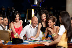 Happy caucasian friends playing blackjack Stock Image