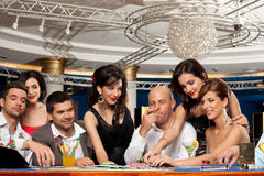 Happy caucasian friends playing blackjack in casin royalty free stock image