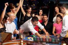 Free Happy Caucasian Friends Playing Roulette In Casino Stock Photos - 20853153