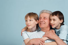 Happy Caucasian grandfather of two boys Royalty Free Stock Images