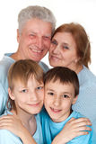 Happy Caucasian grandparents with children fooled. On a light background Stock Photo