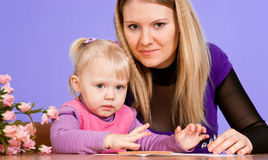 Happy Caucasian luck mom with her daughter Stock Photography