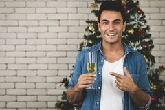 The happy caucasian man is enjoying christmas with his gorgeou stock photography