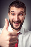 Happy caucasian man showing thumbs up Royalty Free Stock Image