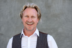 Free Happy Caucasian Man Standing Against A Wall And Laughing Stock Images - 87368764